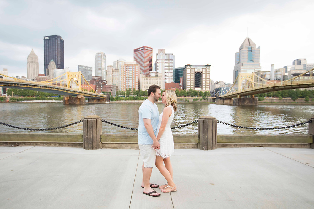 couple in love gazing into each others eyes at their engagement session on the North Shore of Downtown Pittsburgh