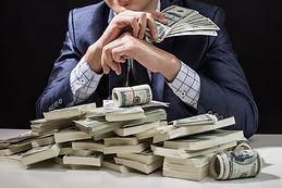 Man holding Money in hand at Black Backg