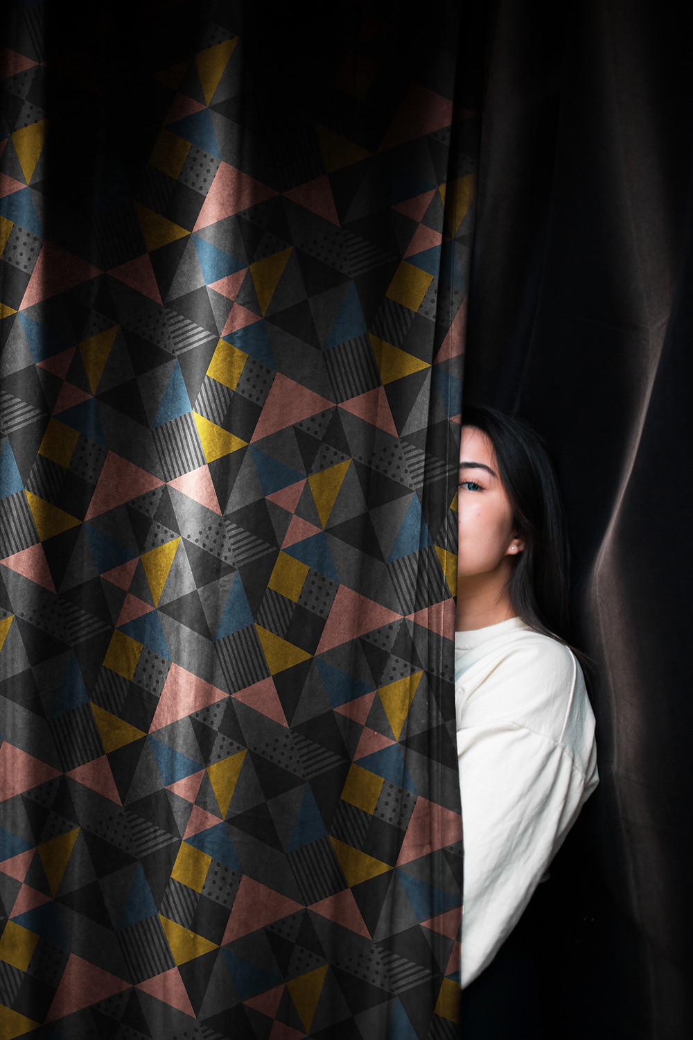 A woman behind a curtain - hiding like some copy blocks I could mention