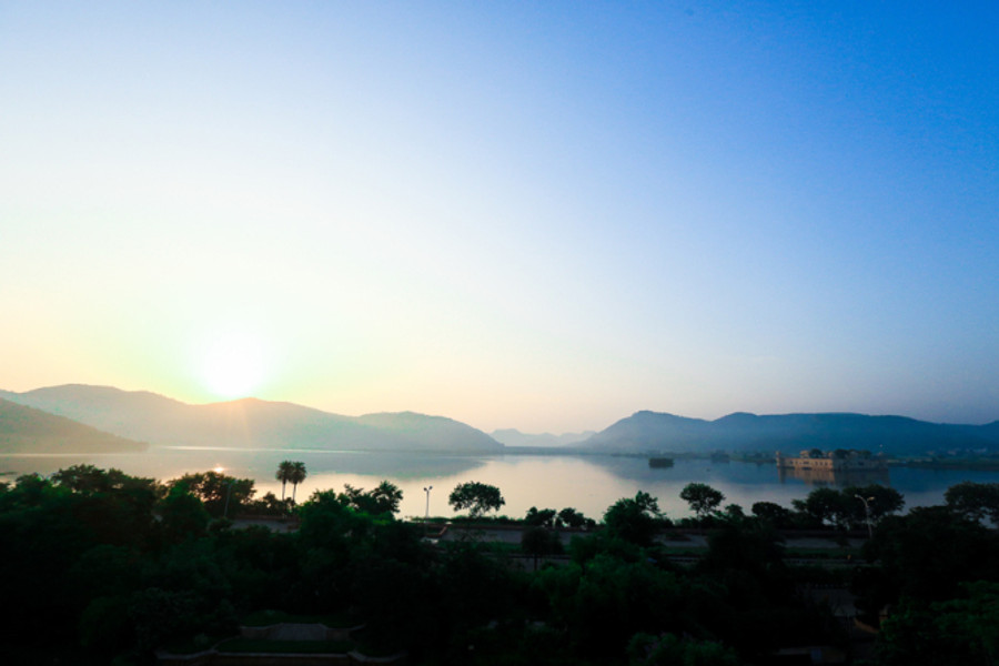 Woke up at 6am to catch the sun rise on one with Jal Mahal on the other.