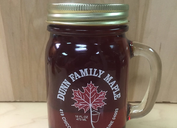 One Mason jar mug full of pure Maine maple syrup.