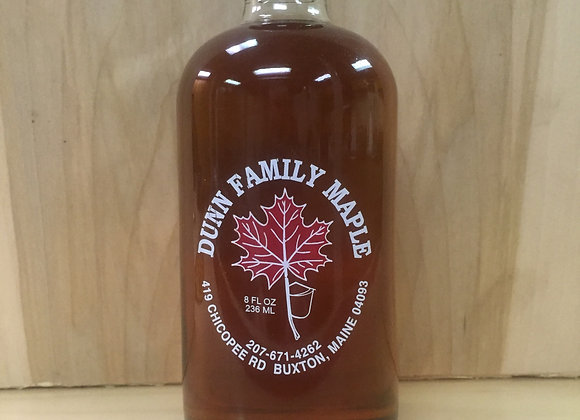 1/2 pint of pure Maine maple syrup in Boston round glass container.