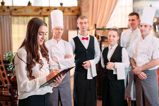 restaurant-manager-his-staff-kitchen-int