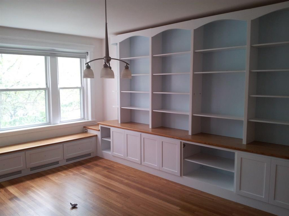 Full Wall Shelving with Benches Under Windows
