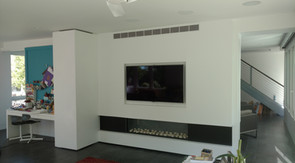 Wall with Moveable Rolling Hidden Shelving Closed