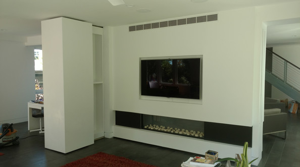 Wall with Moveable Rolling Hidden Shelving Open