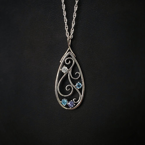 Aisling filigree pendant with blue gradient.