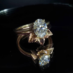 9k yellow gold engagement ring with 1 carat diamond and leaf trio band