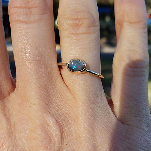 Mandragora yellow gold ring with black opal