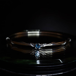 Sterling silver bangle with London Blue topaz