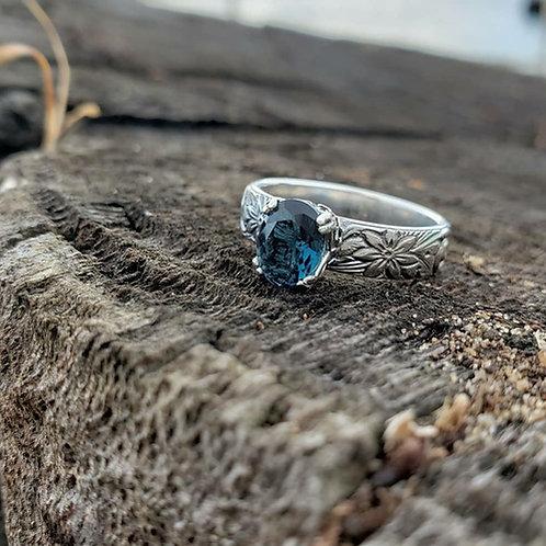 Alchemy ring with London blue topaz