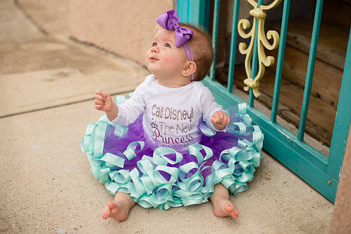 purple and aqua tutu on a toddler