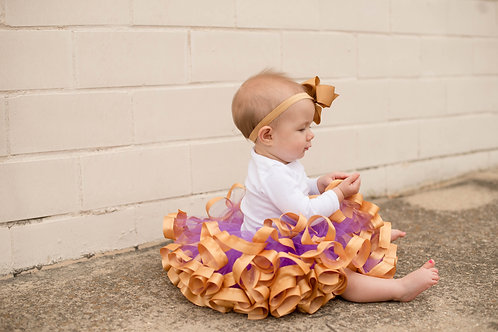 purple and gold birthday tutu on toddler girl