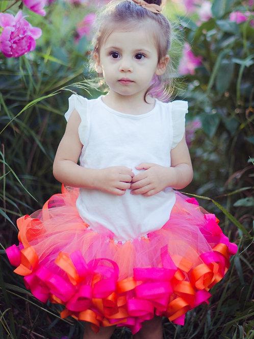 pink and orange tutu on toddler girl