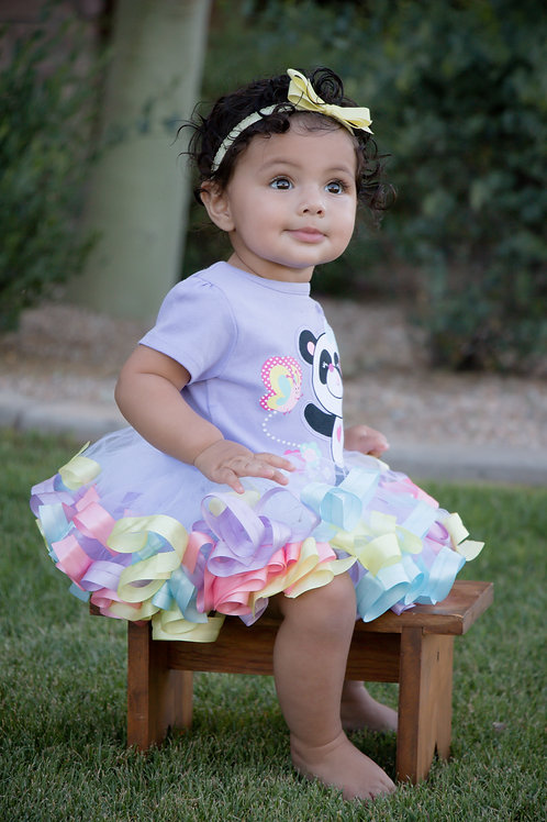 pastel rainbow tutu on a baby girl