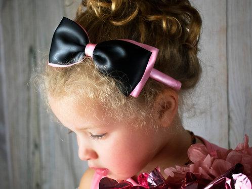 pink and black headband on girl