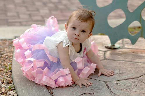 pink and purple tutu skirt on baby girl