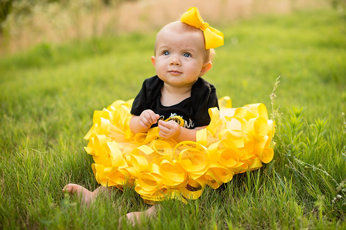 yellow tutu on baby girl