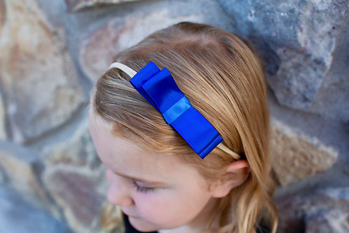 royal blue hair bow on small girl