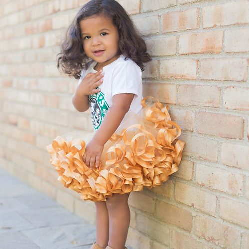 gold tutu skirt on a toddler girl