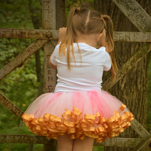 pink and gold tutu skirt on toddler girl