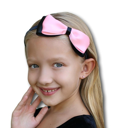 black and pink bow for a child