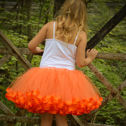 tween wearing an orange tutu