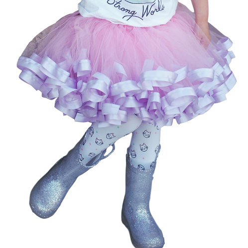 pink and purple tutu skirt on small child