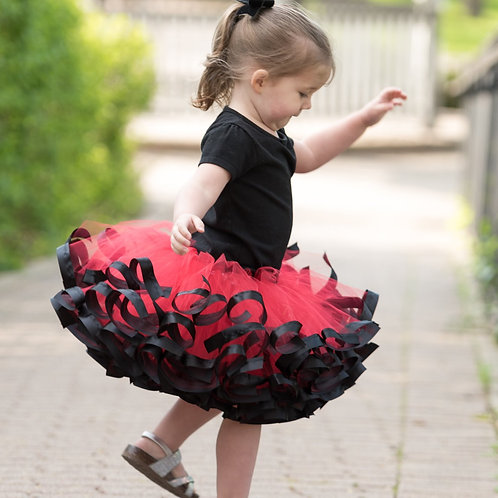 red and black tutu on toddler girl