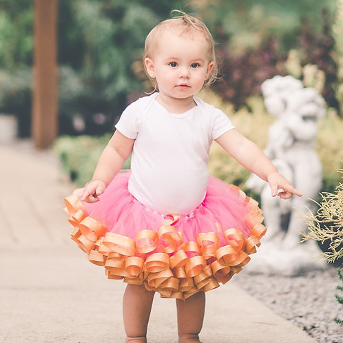 pink and gold tutu on a toddler