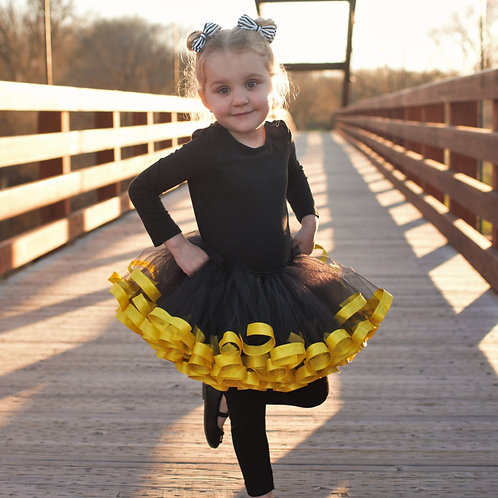 black and yellow tutu on small child