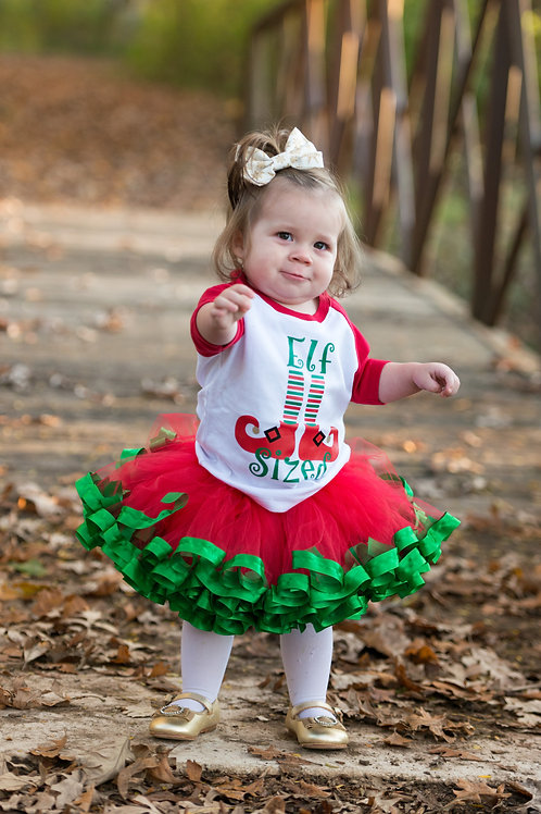 red and green christmas outfit on toddler girl