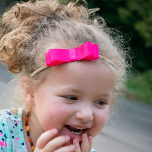 hot pink headband in curly hair