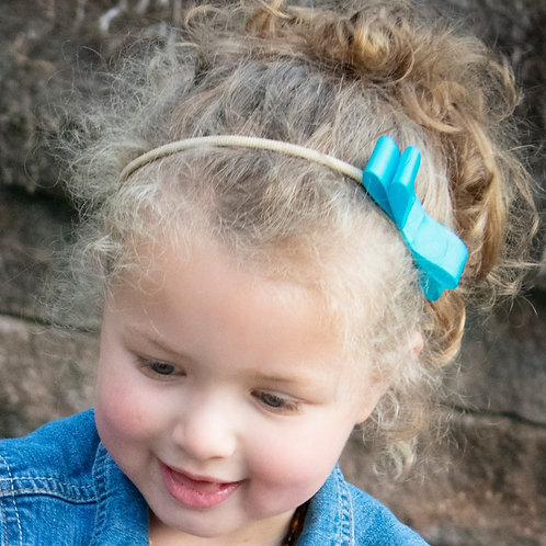 small turquoise bow in curly hair
