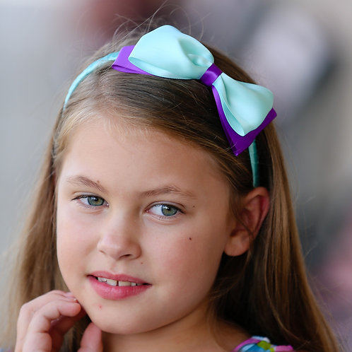 aqua and purple bow on girl with long hair