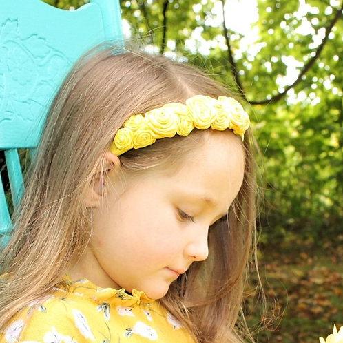 yellow flower head band on little girl