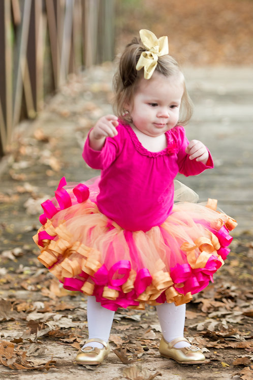 pink and gold tutu skirt on toddler