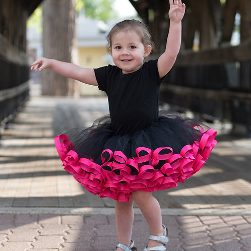 pink and black tutu on a small child
