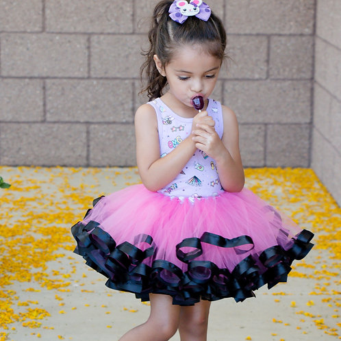 pink and black tutu on a child