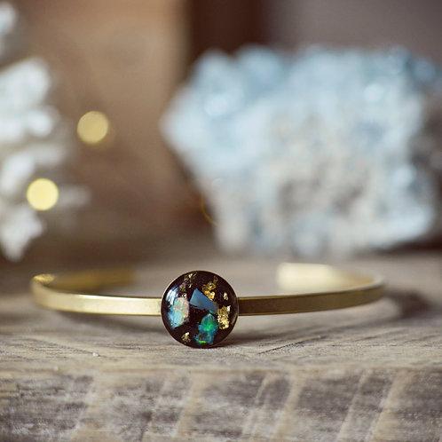 The Opal bracelet~  set on black enamel base with gold leaf flake