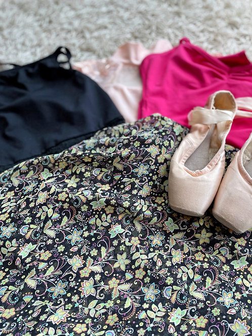 Evie Ballet Wrap Skirt. Ditsy Florals on a dark background with a selection of leo, and some pointe shoes