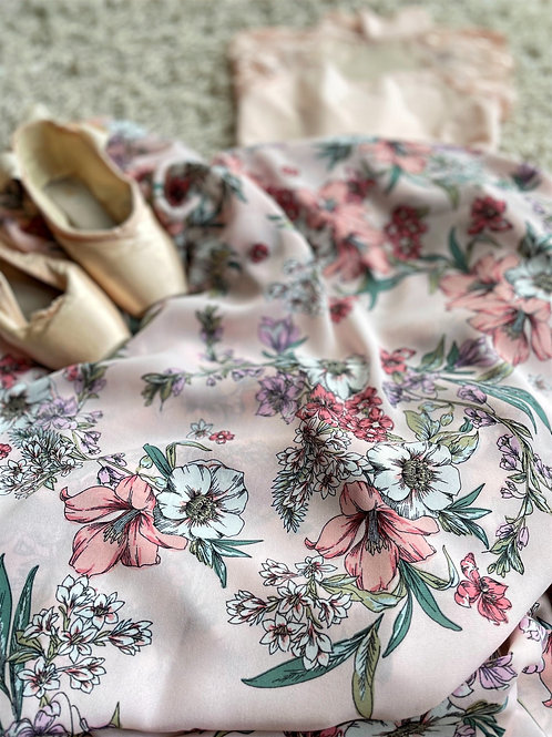 Ballet wrap skirt. Peach and cream flowers on a pale pink background. Shown with a peach leo and pointe shoes