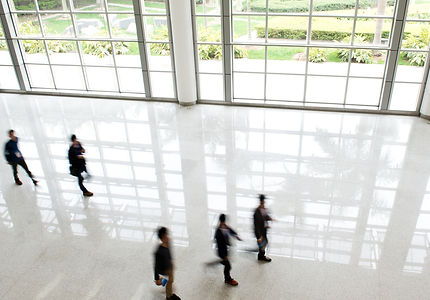 Professionls walking in a large hallway
