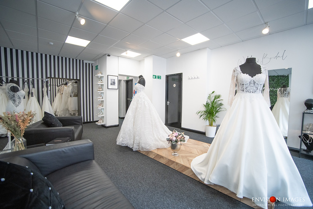 Our monochrome showroom with ballgown wedding dresses created from lace and mikado.
