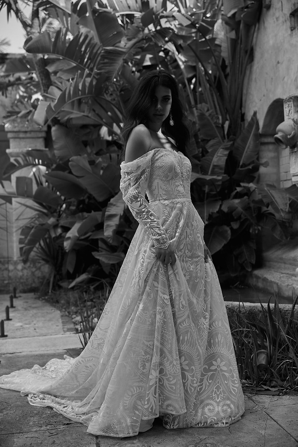 The Rogue gown sleeves and aline skirt created from the most beautiful lace fabric.