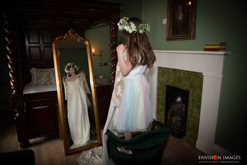 Girl trying on mums wedding dress | Willow Bridal | Envision Images