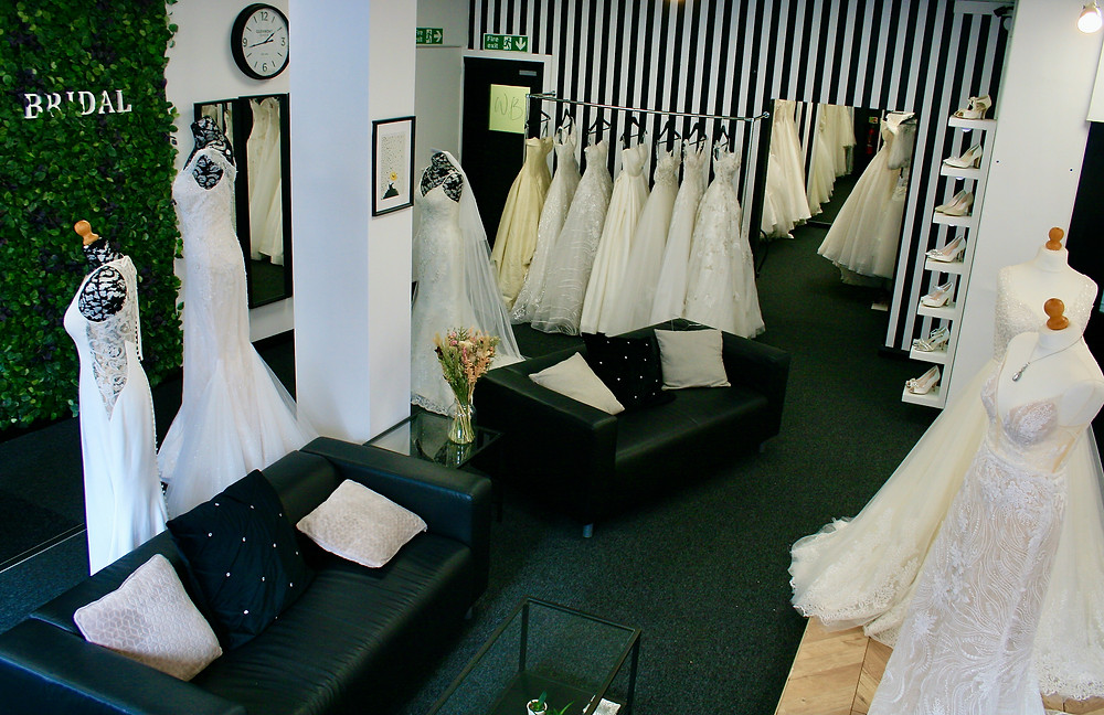 Willow Bridal's Boutique Interior with black leather sofas and striped wall.