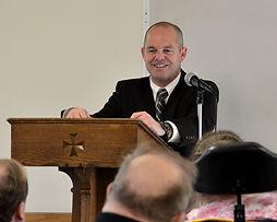Pastor preaching to seniors