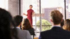 young-woman-presenting-business-seminar-