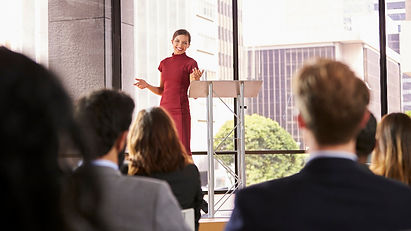 young-woman-presenting-business-seminar-
